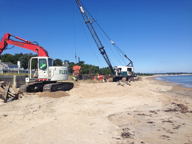 Our excavator worked ahead of the wall crew demolishing the existing seawall